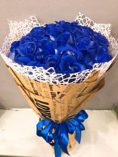 Bó hoa hồng xanh thể hiện niềm tươi mới